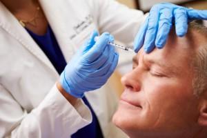 Man Having Botox Treatment At Dental Clinic